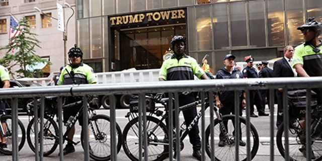 Police stand guard during protests in front of Trump Tower in New York City, New York, U.S., August 14, 2017.