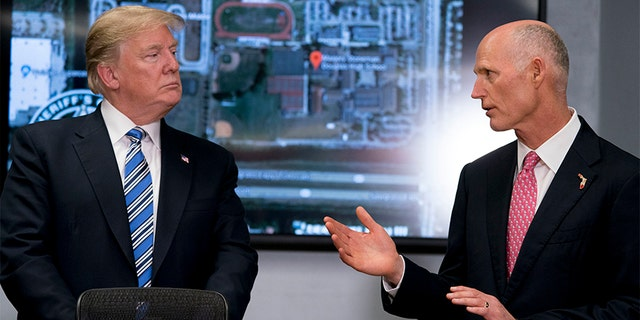 Feb. 16, 2018: Florida Gov. Rick Scott, right, accompanied by President Donald Trump, left, speaks as they meet with law enforcement officers at the Broward County Sheriff's Office in Pompano Beach, Fla. Both Trump and Scott have blasted the FBI in the wake of the Florida high school shooting.