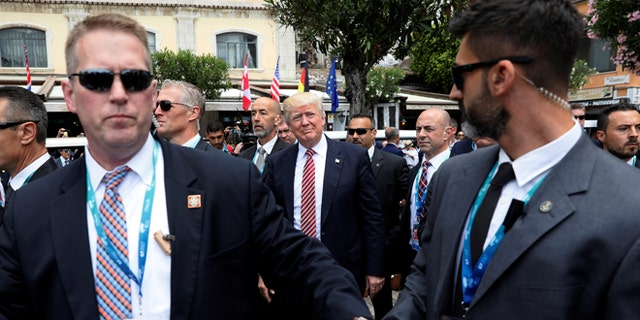 U.S. President Donald Trump is surrounded by Secret Service for an event with fellow G7 leaders during their summit in Taormina, Sicily, Italy, May 26, 2017. REUTERS/Jonathan Ernst - RTX37R3H