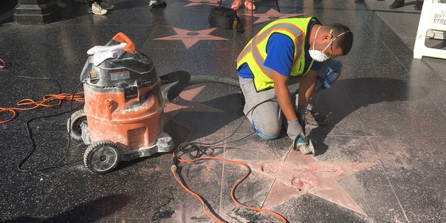 A repair worker tends to Donald Trump's destroyed star on the Hollywood Walk of Fame.