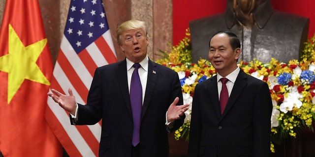 U.S. President Donald Trump (L) gestures as he poses with his Vietnamese counterpart Tran Dai Quang during a welcoming ceremony at the Presidential Palace in Hanoi, Vietnam November 12, 2017. Trump has high approval ratings in Vietnam.