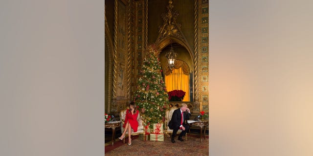President Donald Trump and first lady Melania Trump make Christmas calls to children from their home at Mar-a-Lago in Palm Beach, Fla., Dec. 24, 2017.