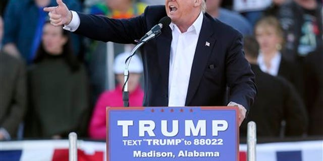 Republican presidential candidate Donald Trump points as he speaks during a rally Sunday, Feb. 28, 2016, in Madison, Ala. (AP Photo/John Bazemore)