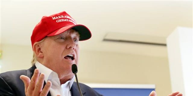 FILE - In this July 30, 2015 file photo, Republican presidential candidate Donald Trump speaks to the media during a news conference on the first day of the Women's British Open golf championship on the Turnberry golf course in Turnberry, Scotland. Republican presidential candidates dismissed Trump's dominance in early primary polling, scrambling to position themselves days before their first debate. (AP Photo/Scott Heppell, File)