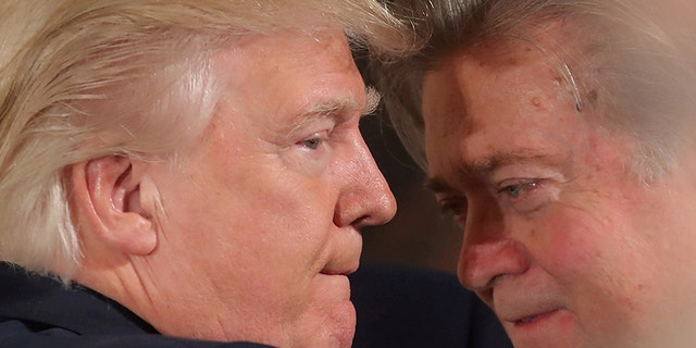 FILE PHOTO:  U.S. President Donald Trump talks to chief strategist Steve Bannon during a swearing in ceremony for senior staff at the White House in Washington, U.S. January 22, 2017. REUTERS/Carlos Barria/FILE PHOTO     TPX IMAGES OF THE DAY - RC11E229E6A0