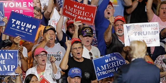 Supporters cheers for President Donald Trump as he speaks during a rally Thursday, Aug. 3, 2017, in Huntington, W.Va. (AP Photo/Darron Cummings)