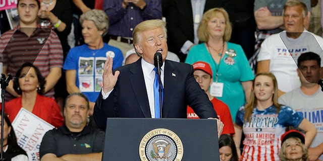 President Donald Trump speaks during a rally at the Covelli Centre, Tuesday, July 25, 2017, in Youngstown, Ohio. (AP Photo/Tony Dejak)