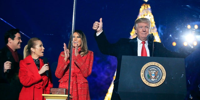 President Trump and first lady Melania Trump cheer after lighting the 2017 National Christmas Tree.