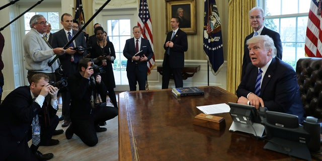 The president's buzzer is seem from another angle, directly beside his phones.
