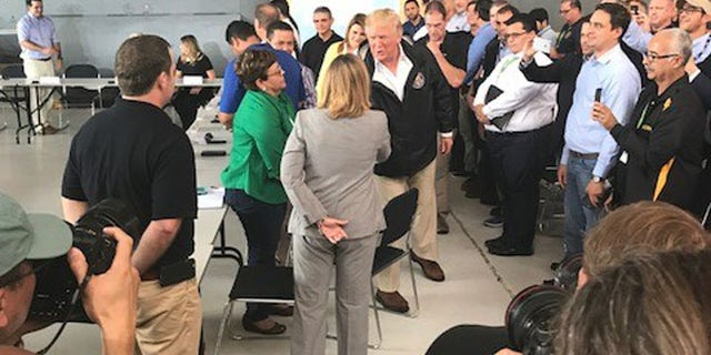 President Trump is seen greeting San Juan Mayor Carmen Yulin Cruz, who has repeatedly criticized the president's actions since the storm wreaked havoc on the territory last month.