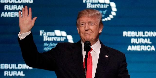 President Donald Trump waves as he speaks at the American Farm Bureau Federation annual convention Monday, Jan. 8, 2018, in Nashville, Tenn.