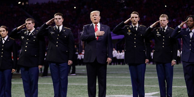 President Trump attended the NCAA championship game in Atlanta on Monday, standing for the National Anthem prior to the start of the game.
