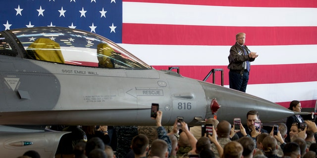 President Donald Trump applauds on stage after speaking at a hanger rally at Yokota Air Base, Sunday, Nov. 5, 2017, in Fussa, on the outskirts of Tokyo, Japan. Trump is on a five country trip through Asia traveling to Japan, South Korea, China, Vietnam and the Philippians. (AP Photo/Andrew Harnik)