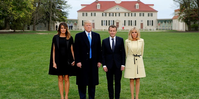President Donald Trump, first lady Melania Trump, French President Emmanuel Macron and his wife, Brigitte Macron, have their picture taken on a visit to the estate of the first U.S. President George Washington in Mount Vernon, Va., on Monday.