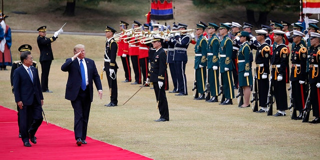 President Trump walks with South Korea's President Moon Jae-in during a welcoming ceremony at the Presidential Blue House in Seoul Tuesday, Nov. 7, 2017.
