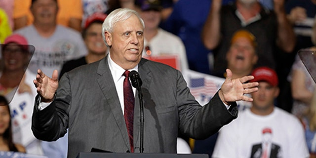 West Virginia Gov. Jim Justice speaks during a rally Thursday, Aug. 3, 2017, in Huntington, W.Va. Justice, a Democrat, announced that he is switching parties to join the Republicans. (AP Photo/Darron Cummings)