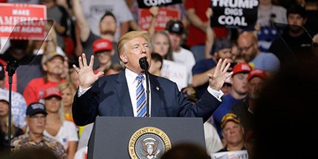 President Donald Trump speaks during a rally Thursday, Aug. 3, 2017, in Huntington, W.Va. (AP Photo/Darron Cummings)
