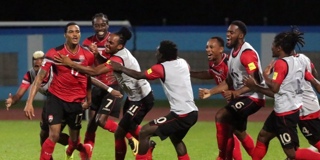 Alvin Jones celebrates his first-half goal that put Trinidad up 2-0 over the U.S.