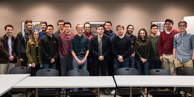 The Tufts Republicans gather for a group photo during the latest club meeting on campus.
