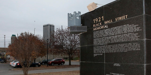 A memorial to Tulsa's Black Wall Street sits outside the Greenwood Cultural Center on the outskirts of downtown Tulsa, Oklahoma.