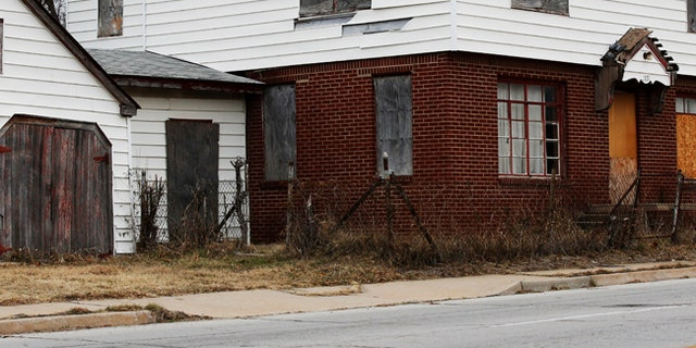 A boarded-up home is seen in north Tulsa, Okla., in December 2016.