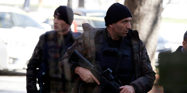Police patrol the Sultanahmet district after an explosion.
