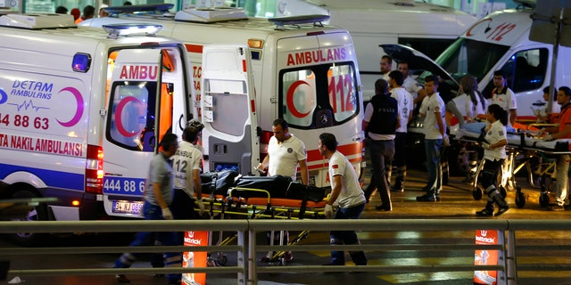 Ambulances arrive at Turkey's largest airport, Istanbul Ataturk, after two suicide blasts.