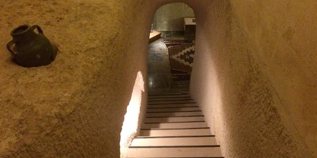 Entering your cave hotel might be a bit creepy, but once down the steps, surprises and history await.