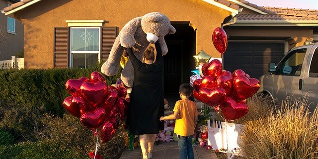 "Jan. 18, 2018: Neighbor Liza Tozier, and her son, Avery Sanchez, 6, drop off his large ""Teddy"" as a gift for the children who lived in the Turpin's home."