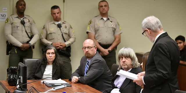 Jan. 18, 2018: Louise Turpin, far left, with attorney Jeff Moore, second from left, and her husband David Turpin, listen to attorney, David Macher, as they appear in court for their arraignment in Riverside, Calif.