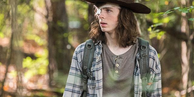 "Chandler Riggs as Carl Grimes in ""The Walking Dead,"" Season 8, Episode 6."