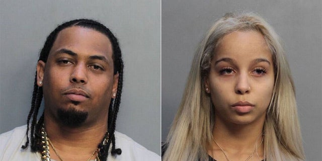 """Ras Cates and Lizmixell Batista were charged with """"armed drug dealing among other felony charges,"""" police said"""