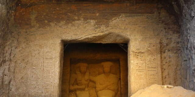 A statue of an ancient Egyptian power couple (a man named Neferkhewe and his wife) from the 18th Dynasty graces a cenotaph at the ancient Egyptian site Gebel el Silsila.