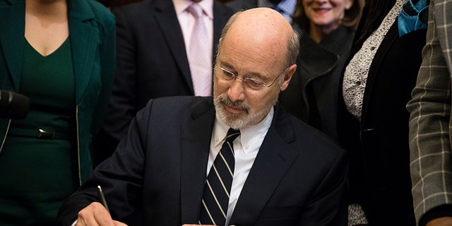 Pennsylvania Gov. Tom Wolf vetoes a bill passed by the Republican-controlled Legislature to limit abortions to the first 20 weeks of pregnancy at City Hall in Philadelphia, Monday, Dec. 18, 2017.