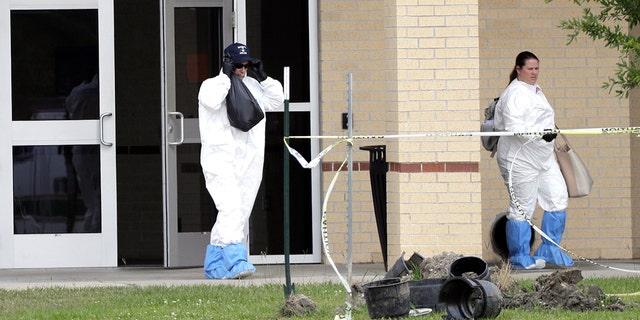 Officials remove items from Santa Fe High School.