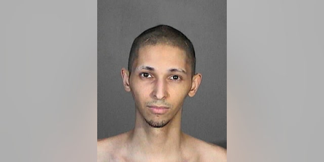 This 2015 booking photo released by the Glendale, Calif., Police Department shows Tyler Raj Barriss.