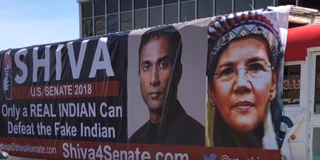 A bus parked outside Shiva Ayyadurai's campaign headquarters taunts Mass. Democratic Sen. Elizabeth Warren's claims of Native American heritage.