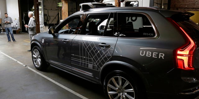 In this Dec. 13, 2016 file photo, an Uber driverless car is displayed in a garage in San Francisco.
