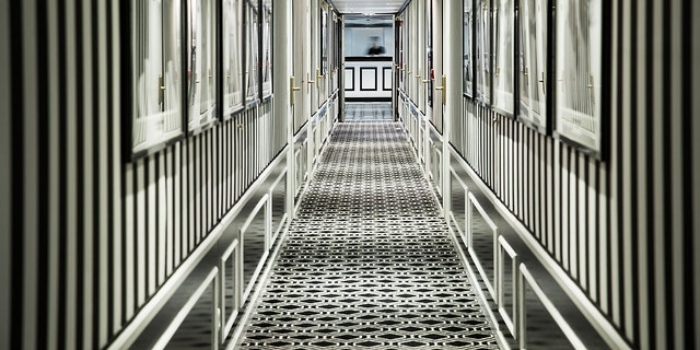 "Chic black-and-white wallpaper lines a hallway on one of the ""millennial"" cruise ships."