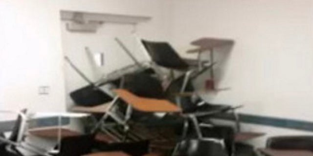 Students piled chairs against the door in the hope that it could keep a gunman at bay.