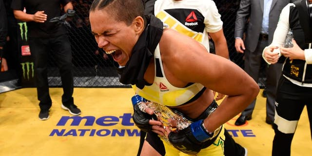 LAS VEGAS, NV - JULY 09: Amanda Nunes of Brazil reacts to her victory over Miesha Tate in their UFC women's bantamweight championship bout during the UFC 200 event on July 9, 2016 at T-Mobile Arena in Las Vegas, Nevada. (Photo by Josh Hedges/Zuffa LLC/Zuffa LLC via Getty Images)