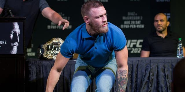 LAS VEGAS, NV - AUGUST 17: UFC featherweight champion Conor McGregor grabs two cans during the during the UFC 202 Press Conference at David Copperfield Theater in the MGM Grand Hotel/Casino on August 17, 2016 in Las Vegas, Nevada. (Photo by Brandon Magnus/Zuffa LLC/Zuffa LLC via Getty Images)