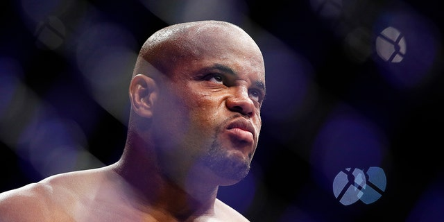 Daniel Cormier stands in the octagon before a heavyweight title mixed martial arts bout against Stipe Miocic at UFC 226.