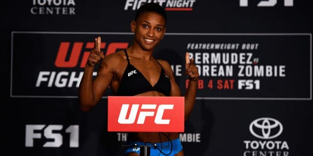 HOUSTON, TEXAS - FEBRUARY 03: Angela Hill poses on the scale during the UFC Fight Night weigh-in at the Sheraton North Houston at George Bush Intercontinental on February 3, 2017 in Houston, Texas. (Photo by Jeff Bottari/Zuffa LLC/Zuffa LLC via Getty Images)