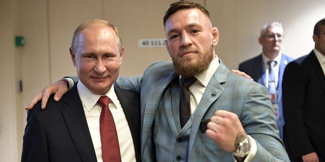Russian President Vladimir Putin, left, and Ultimate fighting star Conor McGregor pose for a photo during the final match between France and Croatia at the 2018 soccer World Cup in the Luzhniki Stadium in Moscow, Russia.