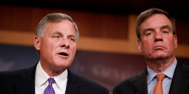 North Carolina Republican Sen. Richard Burr, left, the chairman of the Senate Intelligence Committee, with Warner.