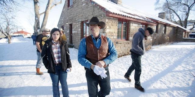 JANUARY 2016: Ryan Bundy, center, one of the sons of Nevada rancher Cliven Bundy, walks through the Malheur National Wildlife Refuge near Burns, Ore. I