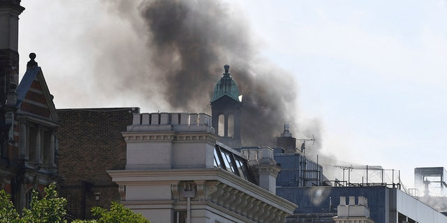 Smoke rises from a building in Knightsbridge, central London, as London Fire Brigade responded to a call of a fire in this upmarket location.