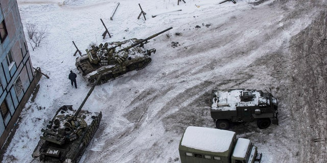 Ukrainian tanks stand in the yard of an apartment block in Avdiivka, eastern Ukraine, Wednesday, Feb. 1, 2017.