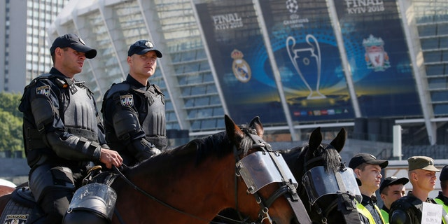Members of the Ukrainian National Police take part in a security exercise during preparations for the Champions League final between Real Madrid and Liverpool outside the NSC Olympic stadium in Kiev, Ukraine May 15, 2018.